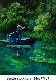 A gardener stands in a boat on Monet's water lily pond In Giverny as he skims leaves out of the water.