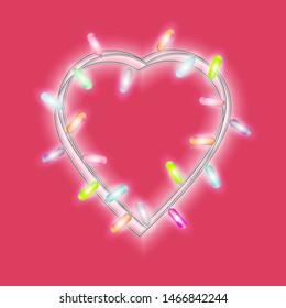 Garland in form of heart with glowing lights isolated on bright pink background. Design element for Holiday cards, valentine's day Christmas, New Year, birthday, banners. Template or mock up