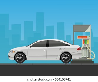 Gas station with car in city background.