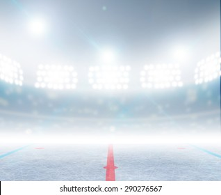 A generic ice hockey ice rink stadium with a frozen surface under illuminated floodlights