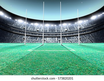 A generic seated aussie rules stadium showing goal posts on a green grass pitch at night under illuminated floodlights - 3D render