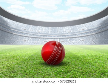 A generic seated cricket stadium with a red ball on a green grass pitch in the day time under a blue cloudy sky - 3D render