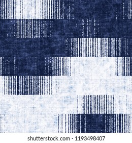 Geometric Ikat Motif Dyed In Mottled Shades Of White And Indigo. Seamless Pattern