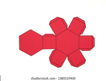Geometric shape cut out of paper and photographed on grey background.Geometry net of Hexagonal prism. 2-dimensional shape that can be folded to form a 3-dimensional shape or a solid.