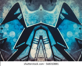 geometric shapes painted on an old concrete wall