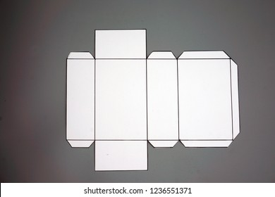 Geometry net of rectangular prism . 2-dimensional shape that can be folded to form a 3-dimensional shape or a solid. Unfolded three Dimensional Figures. Isolated. Top view.