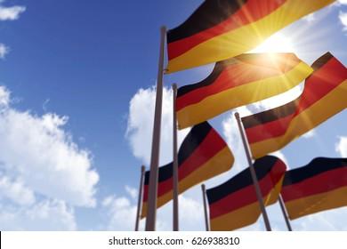 German flags waving in the wind against a blue sky. 3D Rendering