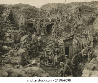 German soldiers relaxing in an extensive, multi-level trench with showing reinforced walls and several underground shelters. Ca. 1916.