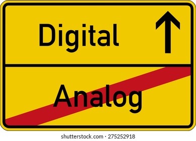 The German words for analog and digital (analog and digital) on a road sign