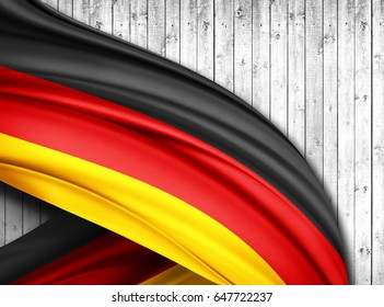 Germany  flag of silk with copyspace for your text or images and wood  background -3D illustration