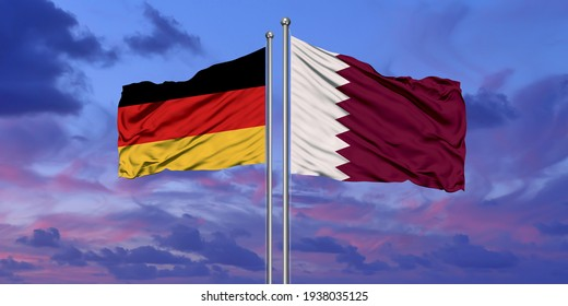 Germany and Qatar flag waving in the wind against white cloudy blue sky together. Diplomacy concept, international relations.3D rendering