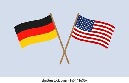 Germany and USA crossed flags on stick. German and American national symbols.