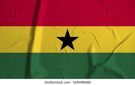 Ghana  flag on crumpled paper background.