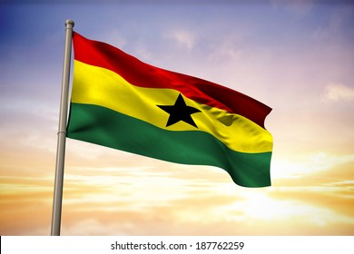 Ghana national flag against beautiful blue and yellow sky
