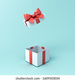Gift box or open present box with red ribbon and bow isolated on cyan green pastel color background with shadow 3D rendering