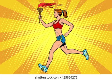 The girl athlete torchbearer sports fire