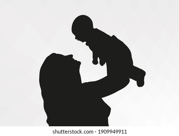 The girl is a young mother with a baby in her arms. Silhouette