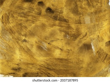 Glamour glistering gold texture. Abstract splattered paper background. Modern art with golden acrylic paint brush strokes and black scratches