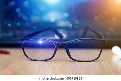 Glasses for filtering blue light from the computer and bokeh.This helps prevent Computer Vision Syndrome.For computer work,Notebook,Office workplace.3D illustration.