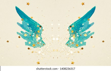 Glitter and glittering stars on abstract blue watercolor wings in vintage nostalgic colors.