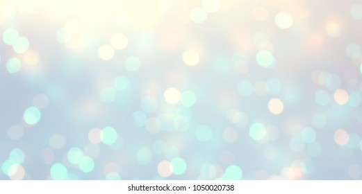 Glitter pale blue defocus template. Bokeh empty background. Snow blurry pattern. Winter lights abstract texture.
