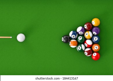 Glossy billiard balls set on a green billiards table