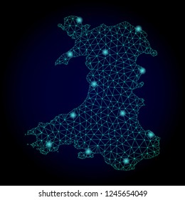 Glossy polygonal mesh map of Wales. Abstract mesh lines, triangles, light spots and points on dark background with map of Wales.