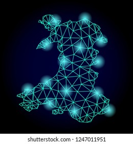 Glossy polygonal mesh map of Wales with glare effect. Abstract mesh lines, triangles, light spots and points on dark background with map of Wales.