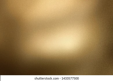 Glowing brushed bronze metallic wall, abstract texture background