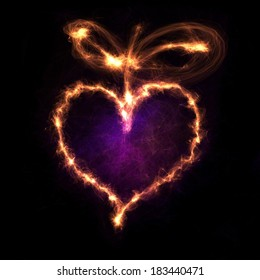 Glowing heart shape with sparkles on dark background