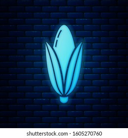 Glowing neon Corn icon isolated on brick wall background.
