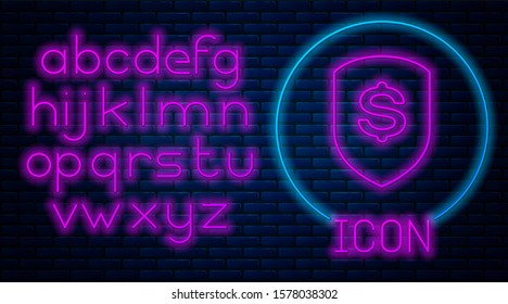 Glowing neon Shield and dollar icon isolated on brick wall background. Security shield protection. Money security concept. Neon light alphabet.