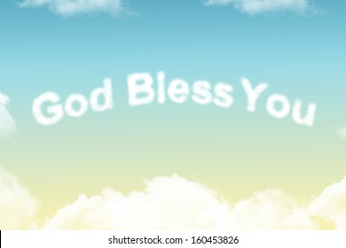 God Bless You - cloud word on yellow to blue gradient background
