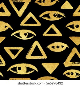 Gold brush drawn eyes and triangles seamless pattern. Rough edges. Hand drawn surreal golden geometrical or egyptian background. Stylized hand drawn eyes, eyeballs, pyramid texture.