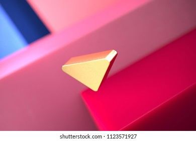 Gold Caret Down Icon on the Pink and Blue Geometric Background. 3D Illustration of Gold Arrow, Caret, Down, Download Icon Set With Color Boxes on the Pink Background.
