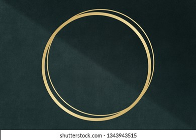 Gold circle frame on a dark gray concrete textured background