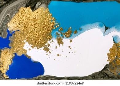 Gold marbling texture design. Blue and golden marble pattern. Fluid art.