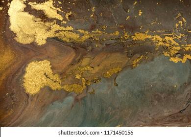 Gold marbling texture design. Golden marble pattern. Fluid art.