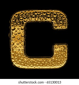 Gold metal three-dimensional alphabet symbol - letter C. Covered with drops of clear water on glossy metal. Isolated on black