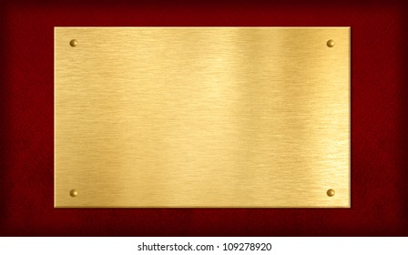 gold plate or plaque on red background