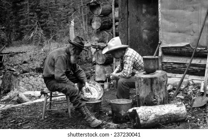 The Gold Rush, miners with gold in a pan, photograph by F,W, Byerly.