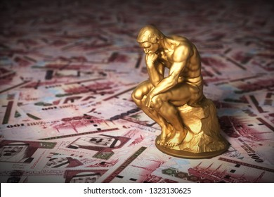 Gold Sculpture Thinker Over Saudi Riyals. 3D Illustration.