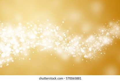 Gold sparkle rays lights with bokeh elegant abstract holiday background.