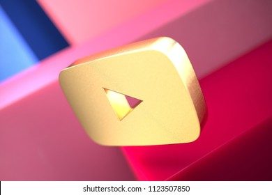 Gold Youtube Play Icon on the Pink and Blue Geometric Background. 3D Illustration of Gold Player, Youtube, Media, Video, Web, Play Icon Set With Color Boxes on the Pink Background.