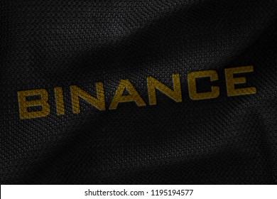 Golden Binance Coin 3D Illustration Write Letter On The Black Fabric. Binance Coin Letter On The Fabric. Golden Binance Coin Letter. 3D Rendering.
