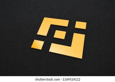 Golden Binance Coin Write On The  Dark Fabric Background. Golden Binance Coin Logo. 3D İllustration.