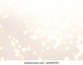 Golden bokeh on blurred beige background. Wedding festive texture. Beautiful backdrop for special events.