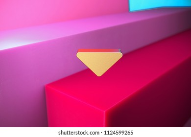 Golden Caret Down Icon on the Magenta and Cyan Geometric Background. 3D Illustration of Gold Arrow, Caret, Down, Download Icon Set With Color Boxes on Magenta Background.