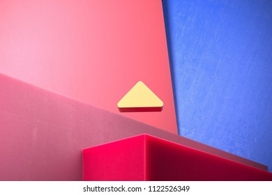 Golden Caret Up Icon on the Blue and Pink Geometric Background. 3D Illustration of Gold Arrow, Caret, Drop Up, Up, Upload Icon Set With Color Boxes on Pink Background.