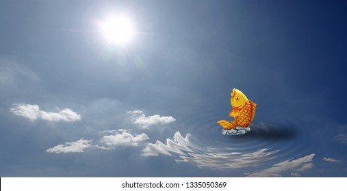 A golden carp fish flipping on a water surface with reflection of the blue sky.